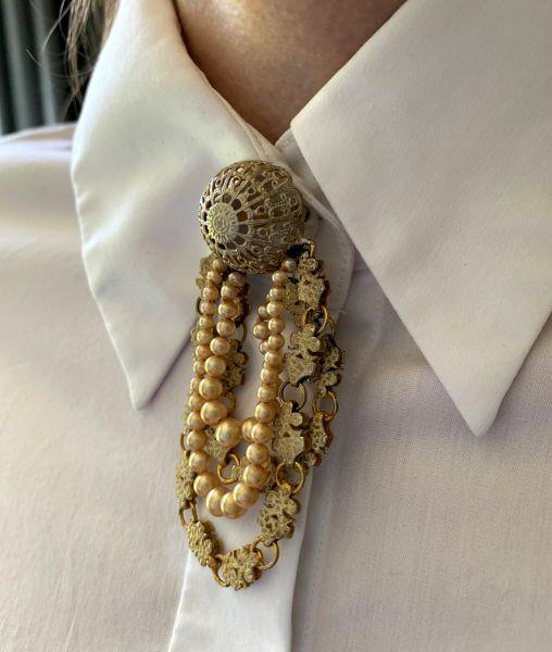 Mitchel Maer brooch with white shirt collar