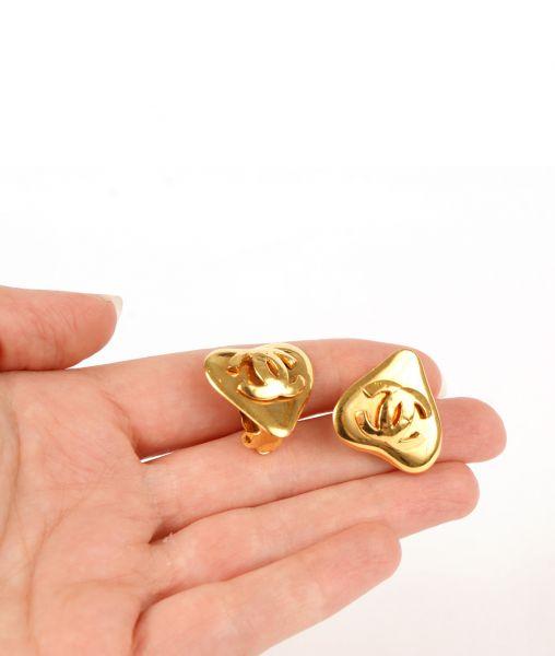 Chanel heart earrings in the hand