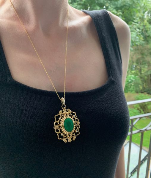 KJL pendant worn on chain